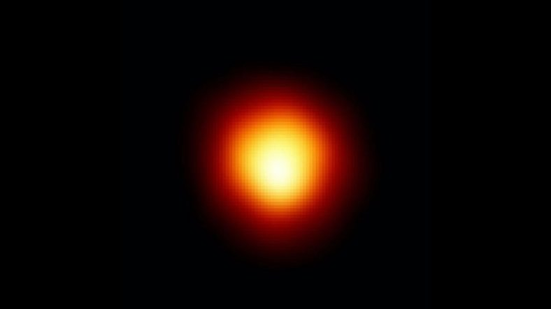 Betelgeuse is Smaller and Closer to Earth than Previously Thought